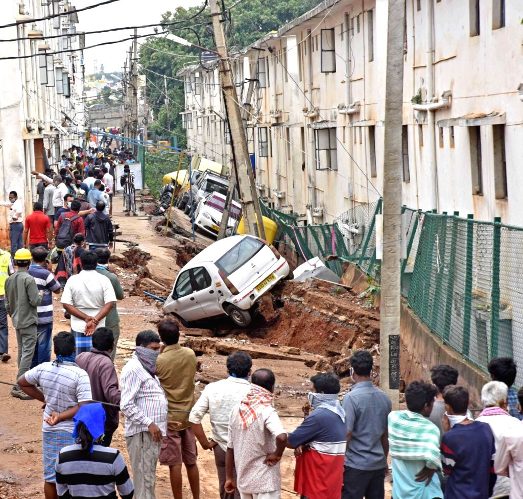 A road damaged due to heavy rains in Lakshmidevi Nagar Slum board quarters in Laggere Ward 69 of Bengaluru during the extended nationwide lockdown imposed to mitigate the spread of ...