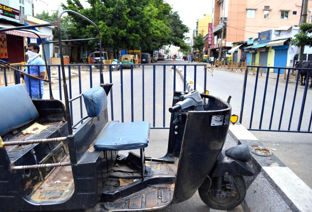 A road remains closed at Kalasipalya area during a strict lockdown that has been re-imposed for 15 days in five wards across Bengaluru to contain the spread of COVID-19 and reduce the ...