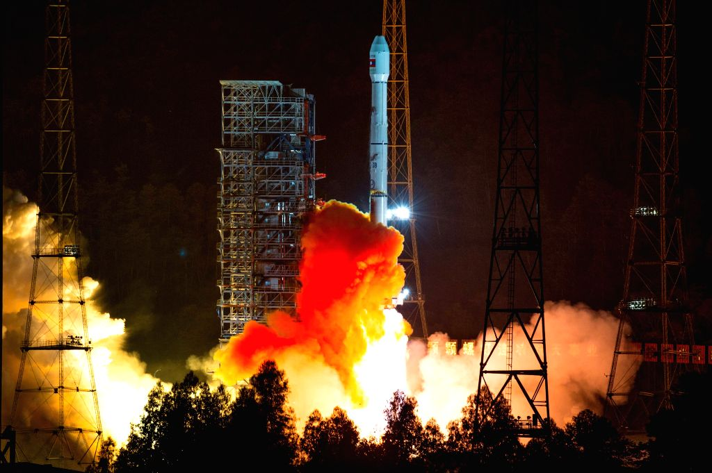 A rocket carrying the LaoSat-1 satellite blasts off from the Xichang Satellite Launch Center in Xichang, southwest China's Sichuan Province, Nov. 21, 2015.  ...