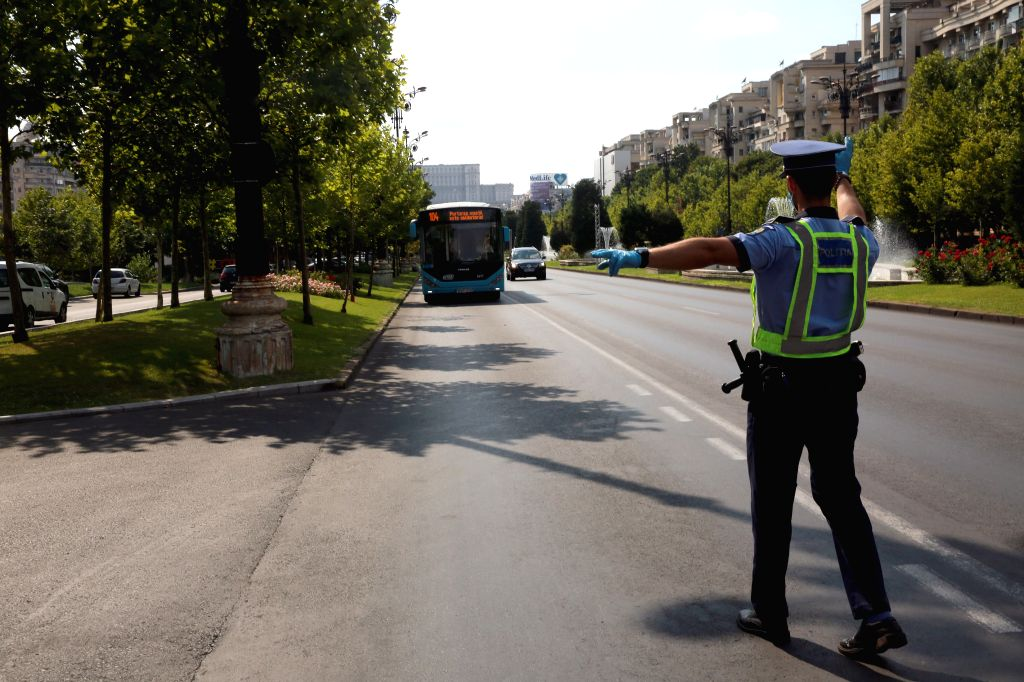 A Romanian Policeman stops a bus to check the use of masks of the passengers, in Bucharest, Romania, on August 1, 2020. Mask-wearing is being made mandatory in ...