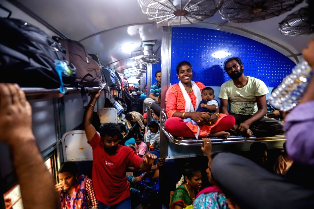 A rush of passengers seen inside a train at the Chennai Egmore railway station as people leave for their hometowns to celebrate Diwali, on Oct 25, 2019.