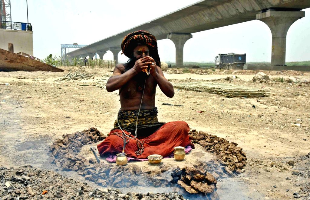 A sadhu offers prayer on World Environment Day, in Patna, on June 5, 2019.