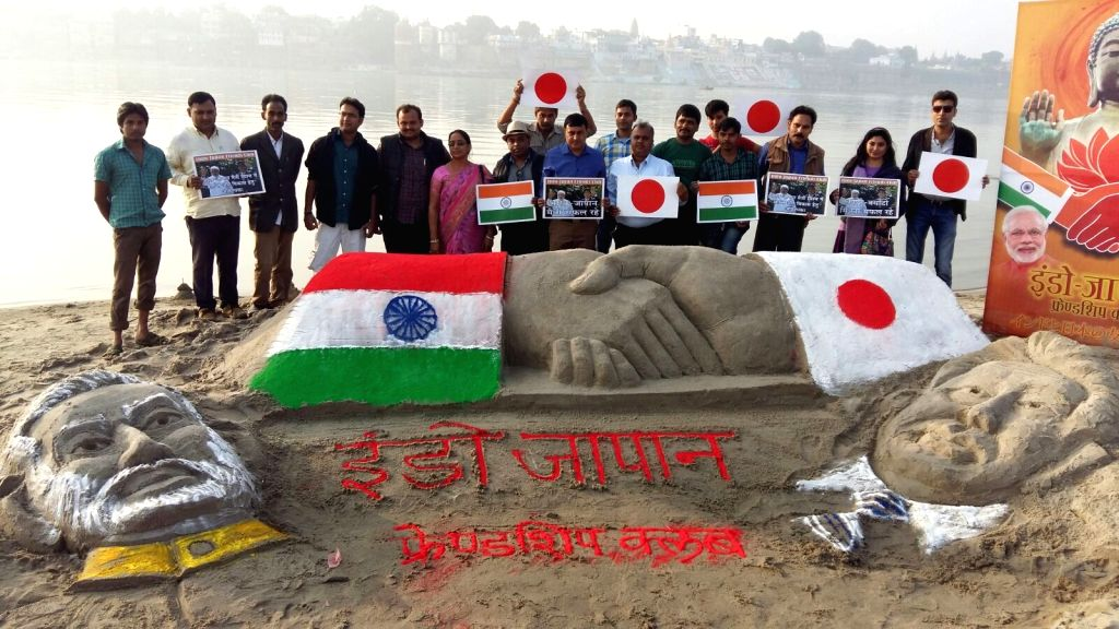 A sand sculpture depicting pictures of Prime Minister Narendra Modi and Japanese Prime Minister Shinzo Abe on the banks of Ganga  in Varanasi, on Dec 11, 2015. - Narendra Modi