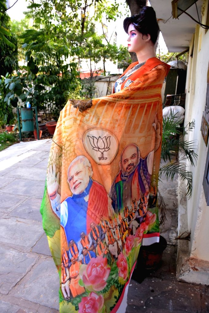 A saree with faces of Prime Minister Narendra Modi and BJP leader Amit Shah on display outside a shop in Jaipur, on March 9, 2019. - Narendra Modi and Amit Shah