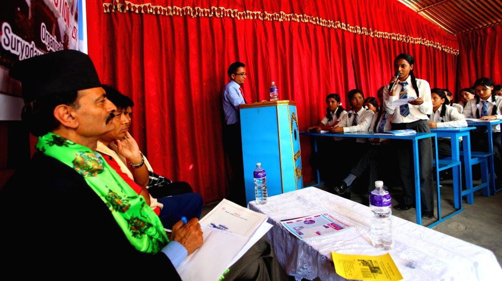 A school kid expresses her opinions and suggestions on the preliminary draft of constitution during an interaction program with Constitution Assembly (CA) ...