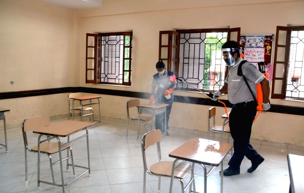 A school premises being sanitised on the eve of the National-Eligibilty-cum-Entrance Test (NEET) examinations that are scheduled to be conducted tomorrow, in Kolkata on Sep 12, 2020.
