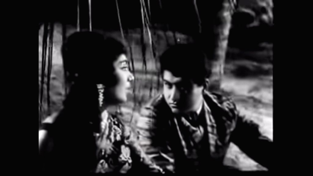 "A screen grab from the song ""Lag Ja Gale Ke Pir Yeh Haseen Raat Ho Na Ho"" of the film ""Woh Koun Thi""."
