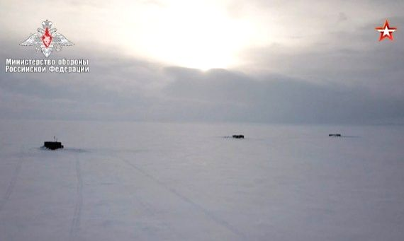 A screenshot of footage released by the Russian Defense Ministry on March 26, 2021 shows that three nuclear-powered missile submarines break thick ice and surface in the Arctic Ocean simultaneously