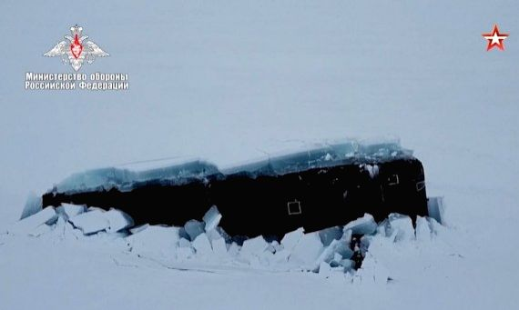 A screenshot of footage released by the Russian Defense Ministry on March 26, 2021 shows that a nuclear-powered missile submarine breaks thick ice and surfaces in the Arctic Ocean