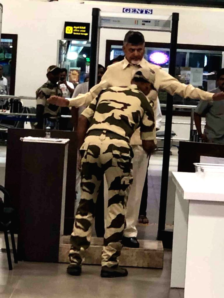 A security personal frisks Former Andhra Pradesh Chief Minister and now leader of opposition N. Chandrababu Naidu at Gannavaram Airport in Vijayawada, on June 14, 2019. The Telugu Desam ... - N. Chandrababu Naidu