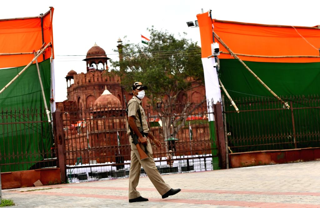 A security personnel deployed at the Red Fort keeps a vigil, on the eve of the 74th Independence Day celebrations, in New Delhi on Aug 14, 2020.