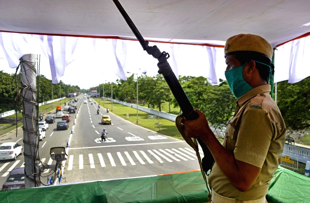 A security personnel keeps a vigil on the eve of the 74th Independence Day celebrations 2020, in Kolkata on Aug 14, 2020.