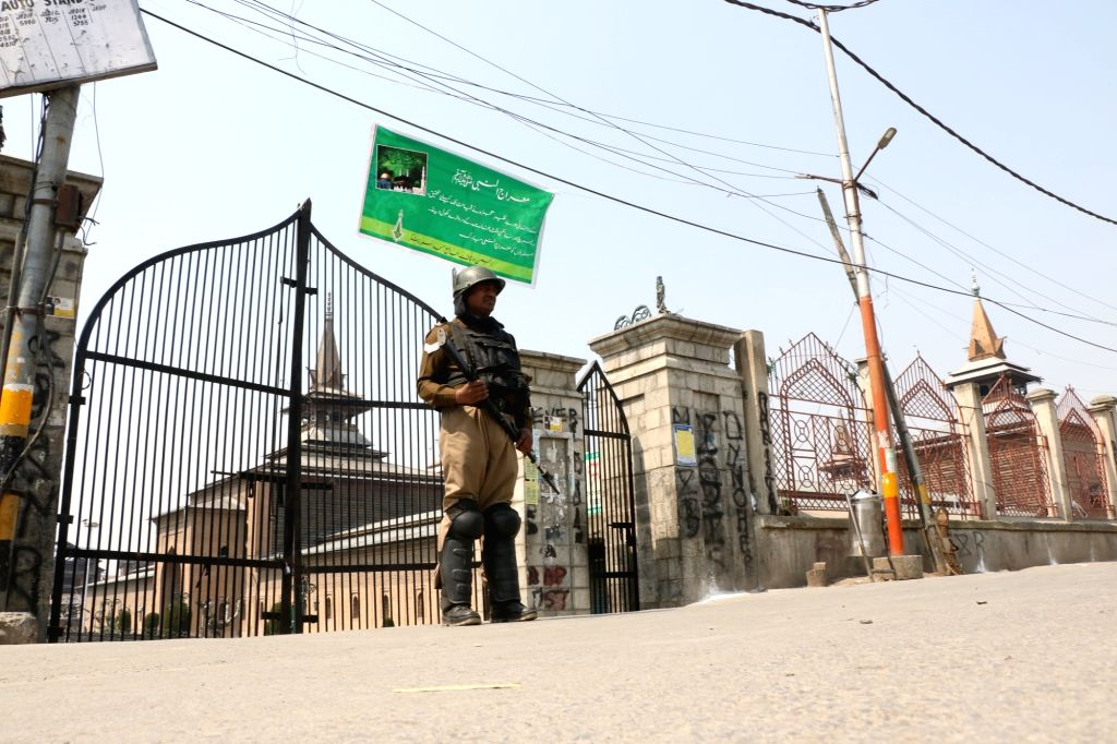 A security personnel stands guard outside the Jamia Masjid in Srinagar, on April 5, 2019. A day after inmates and the jail authorities clashed inside Srinagar Central Jail, police on Friday ...