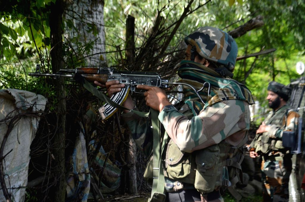 A security personnel takes position during a gunfight with militants in Jammu and Kashmir's Anantnag, on June 8, 2019. One Jaish-e-Muhammad (JeM) militant was killed in the gunfight.