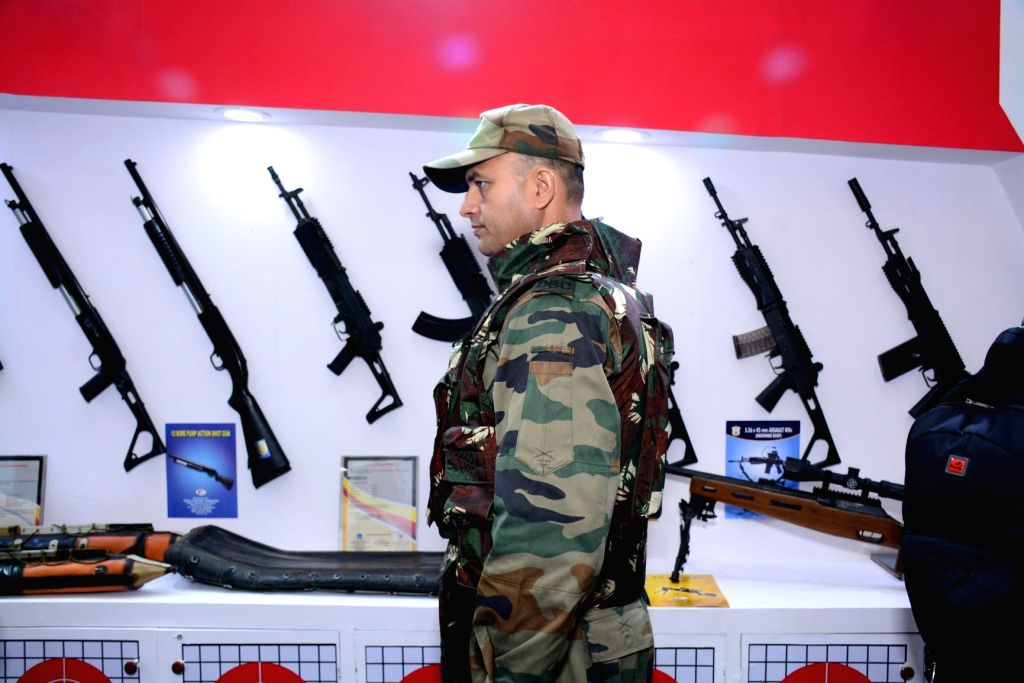 A security personnel wears India's Lightest Bullet Proof Jacket ,Bhabha Kavach, that was launched by Ordnance Factory Board at the International Police Expo 2019, at Pragati Maidan in New ...