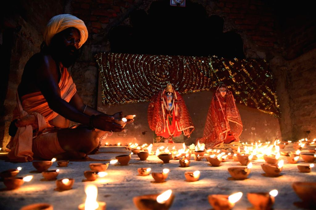 A seer lights earthen lamps at a Ram temple in Patna to mark the 'Bhumi Pujan' of Ram Temple in Ayodhya performed by Prime Minister Narendra Modi on Aug 5, 2020. - Narendra Modi