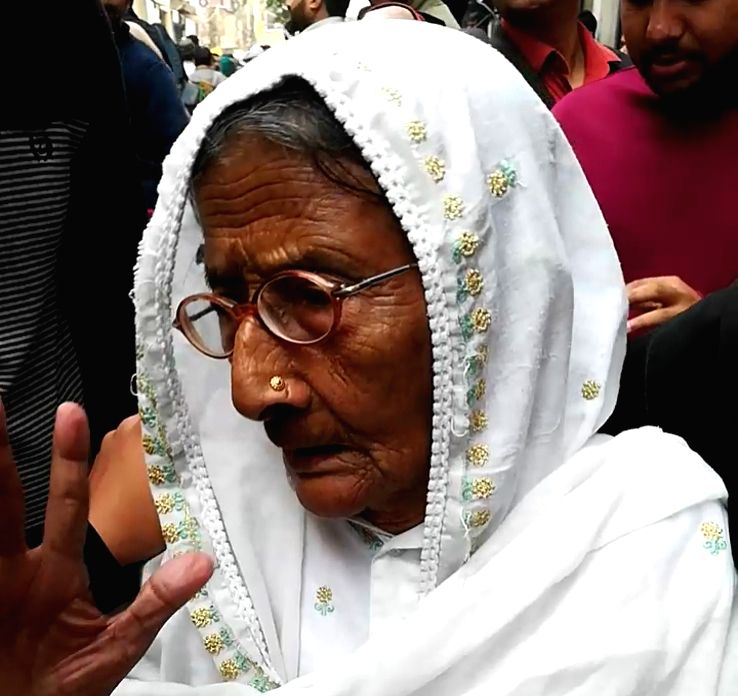A senior citizen arrives to cast her vote for the Delhi Assembly elections 2020, at a polling station at Delhi's Shaheen Bagh on Feb 8, 2020.