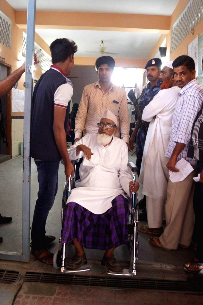 A senior citizen being assisted to a polling station during Telangana Assembly elections in Hyderabad, on Dec 7, 2018.