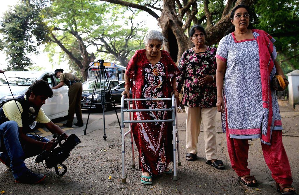A senior citizen (C) arrives at a polling center in Colombo, Sri Lanka, Aug. 17, 2015. Sri Lanka on Monday held elections for a new 225-member parliament. ...