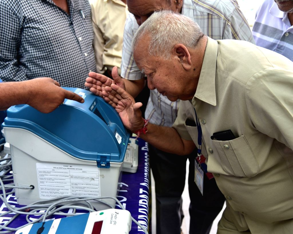 A senior citizen during a voter awareness programme, to demonstrate the functioning of an Electronic Voting Machine (EVM) and Voter Verified Paper Audit Trail (VVPAT) ahead of 2019 Lok Sabha ...