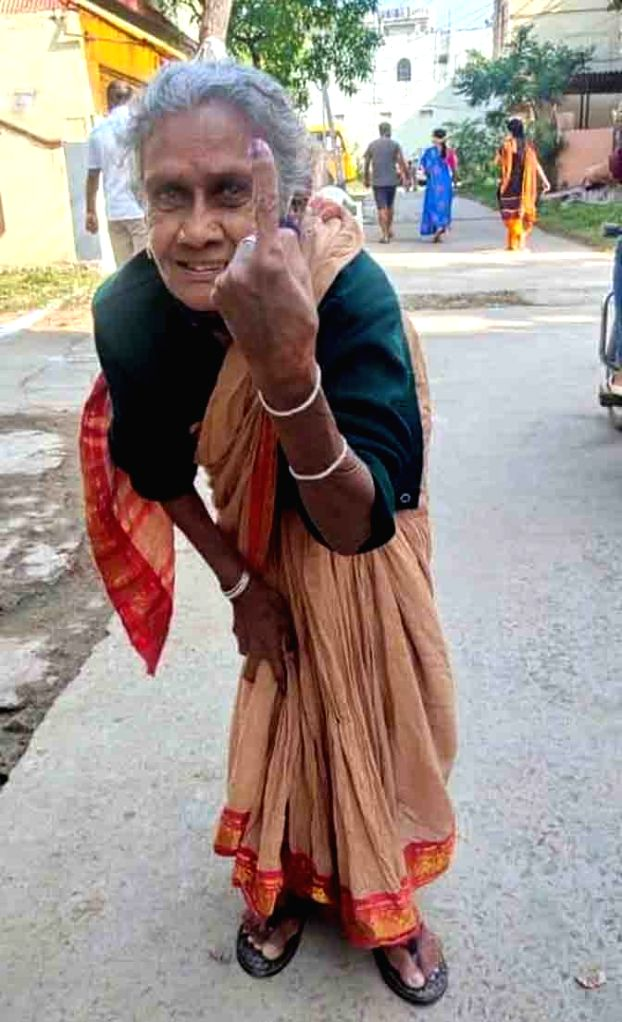 A senior citizen shows her inked finger after casting her vote for Greater Hyderabad Municipal Corporation (GHMC) elections, on Dec 1, 2020.