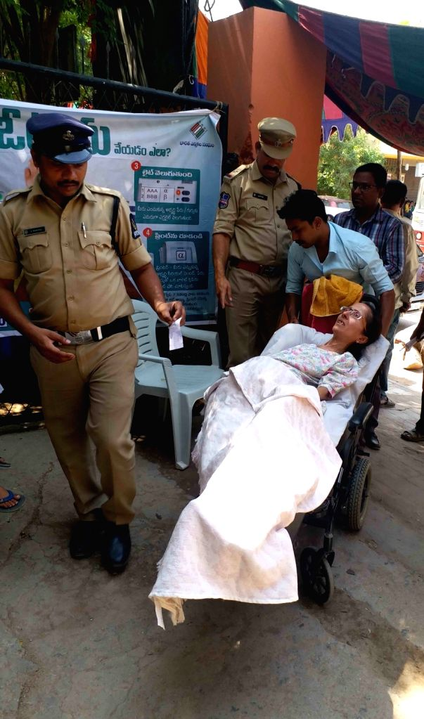 A seriously ill woman being assisted to a polling booth on a stretcher for casting vote for the 2019 Lok Sabha elections, in Hyderabad on April 11, 2019.