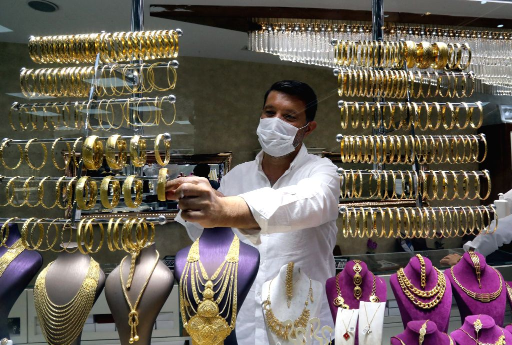 A shop assistant wearing a mask works in a gold store in Ankara, Turkey, on Aug. 7, 2020. Turkey reported 1,185 new COVID-19 cases on Friday, raising the total ... - Fahrettin Koca