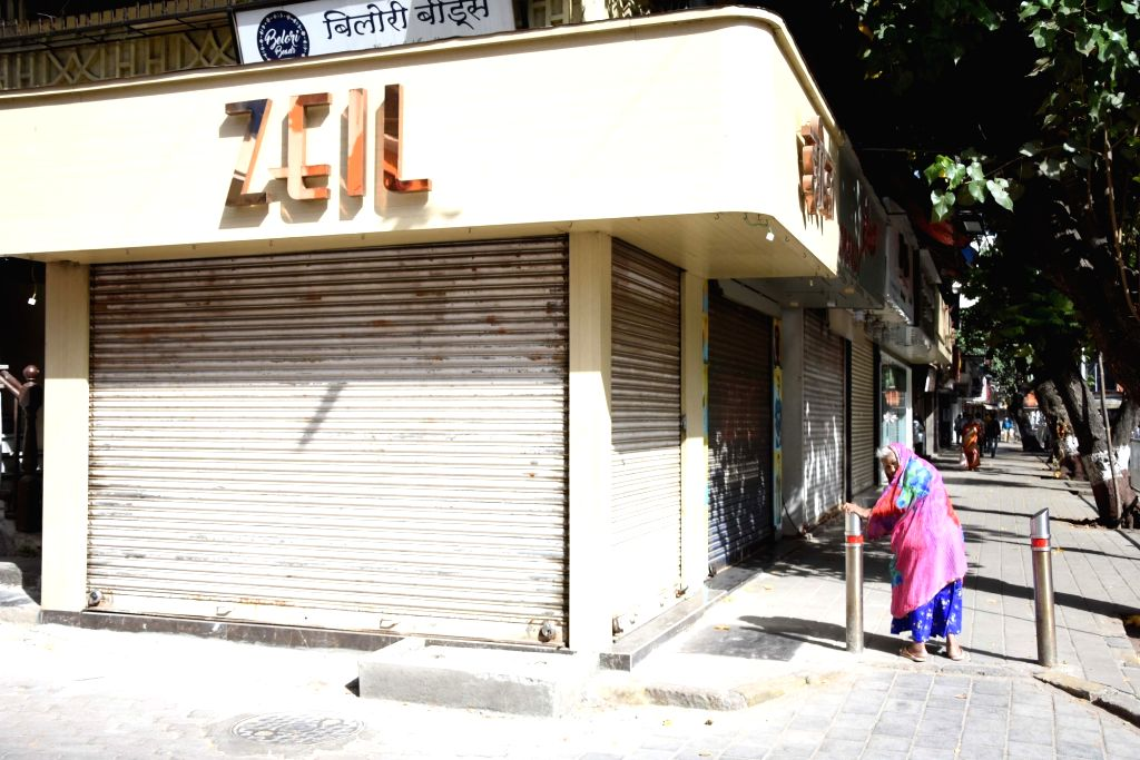 A shop remains shut after Maharashtra Chief Minister Uddhav Thackeray ordered all private offices, shops and commercial establishments to shut down in Mumbai in view of the growing number of ... - Uddhav Thackeray