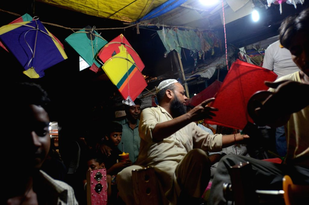 A shopkeeper selling kites in New Delhi. (Photo::: IANS)