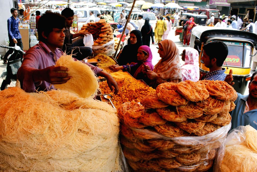 A shopkeeper sells bakeries ahead of of Eid ul-Fitr in Srinagar on July 27, 2014.