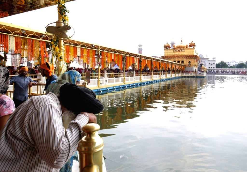 "A Sikh gentleman pays obeisance at the Golden Temple on ""Parkash Purab of Sri Guru Granth Sahib"" in Amritsar on Sept 10, 2018."