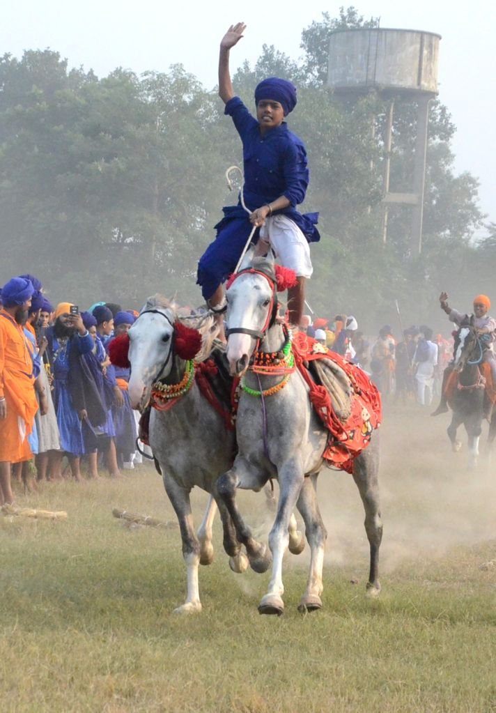 A Sikh 'Nihang' shows his horse riding skills during a religious procession organised on 'Fateh Divas' that marks the victory of the Sikhs against the Mughal Empire in Delhi in 1783, under ... - Baghel Singh