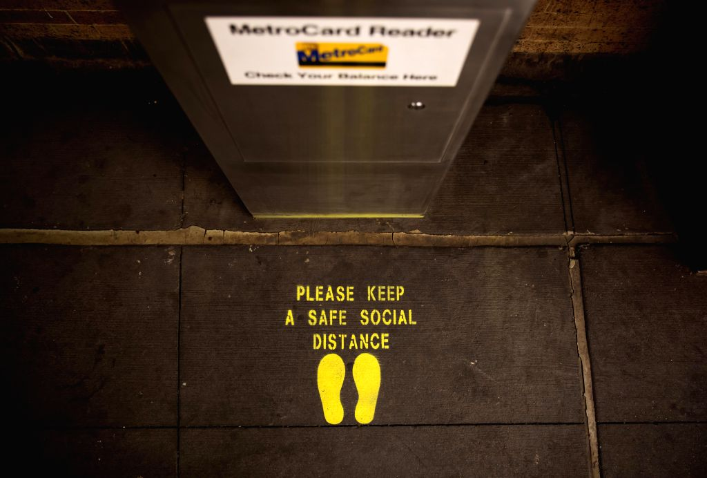 A social distancing mark is displayed at a subway station in New York, the United States, June 25, 2020. The number of COVID-19 cases in the United States topped ...
