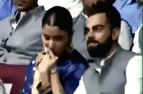 A soft kiss planted on India skipper Virat Kohli's hand by his actress wife Anushka Sharma has taken the Internet by storm. The two were present at the event where the Feroz Shah Kotla Stadium was rechristened after former Finance Minister Arun Jaitl - Arun Jaitley, Virat Kohli and Anushka Sharma