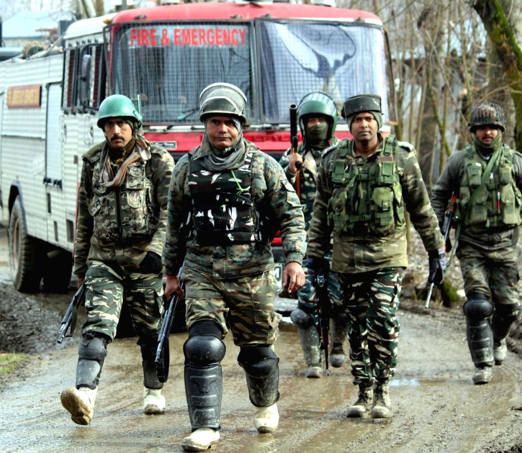 A soldier at the site of an encounter with militants in Jammu and Kashmir's Kupwara district on March 3, 2019. Two militants, five security men and a civilian were killed in the 48-hour-long ...