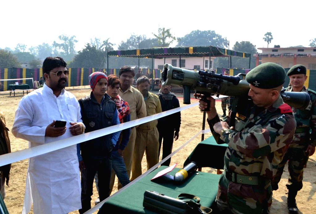 A soldier demonstrates weapons at an arms exhibition ahead of Army Day in Varanasi on Jan 13, 2017.