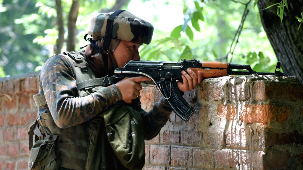 A soldier during an encounter with militants in Pulwama on May 27, 2017. Hizbul Mujahideen commander, Sabzar Bhat who succeeded slain militant, leader Burhan Wani, was killed along with ...