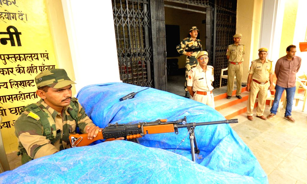A soldier guards a strong room where Electronic Voting Machines (EVMs) are stored at Rajasthan College in Jaipur on April 18, 2014.