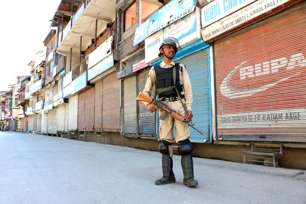 A soldier mans a Srinagar road as curfew and restrictions clamped by authorities continued on May 28, 2017.