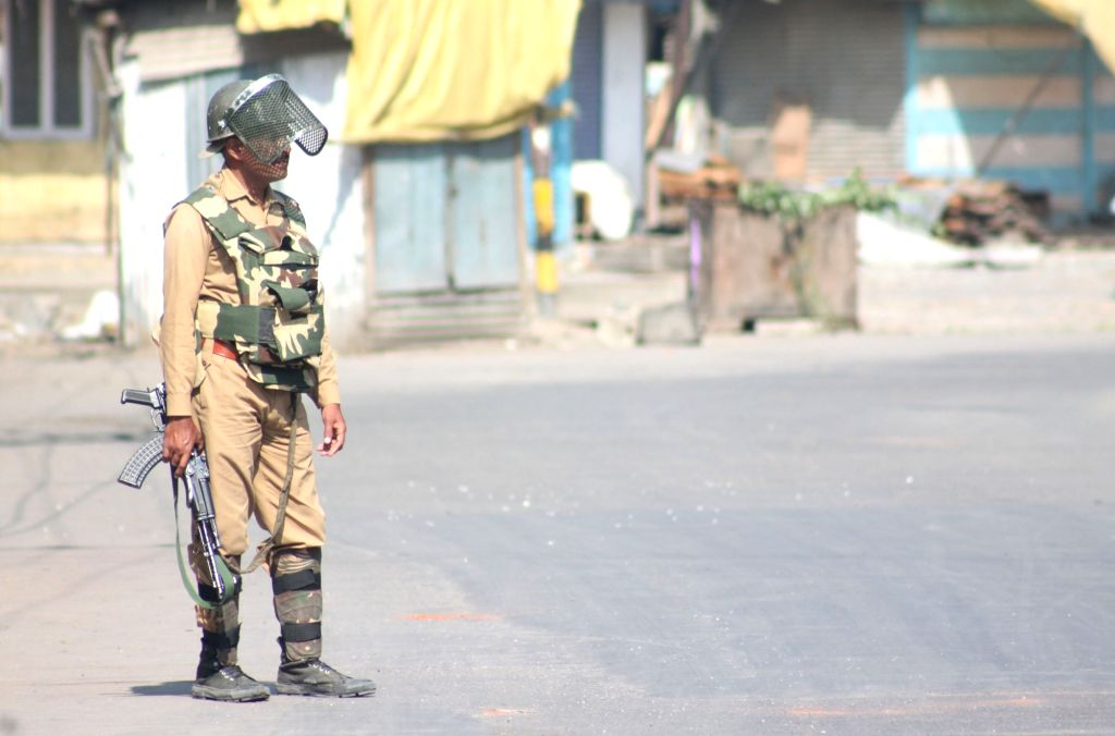 A soldier stands guard as authorities clamp curfew and restrictions amid protest shutdown called by separatists in Srinagar on Aug 1, 2016.