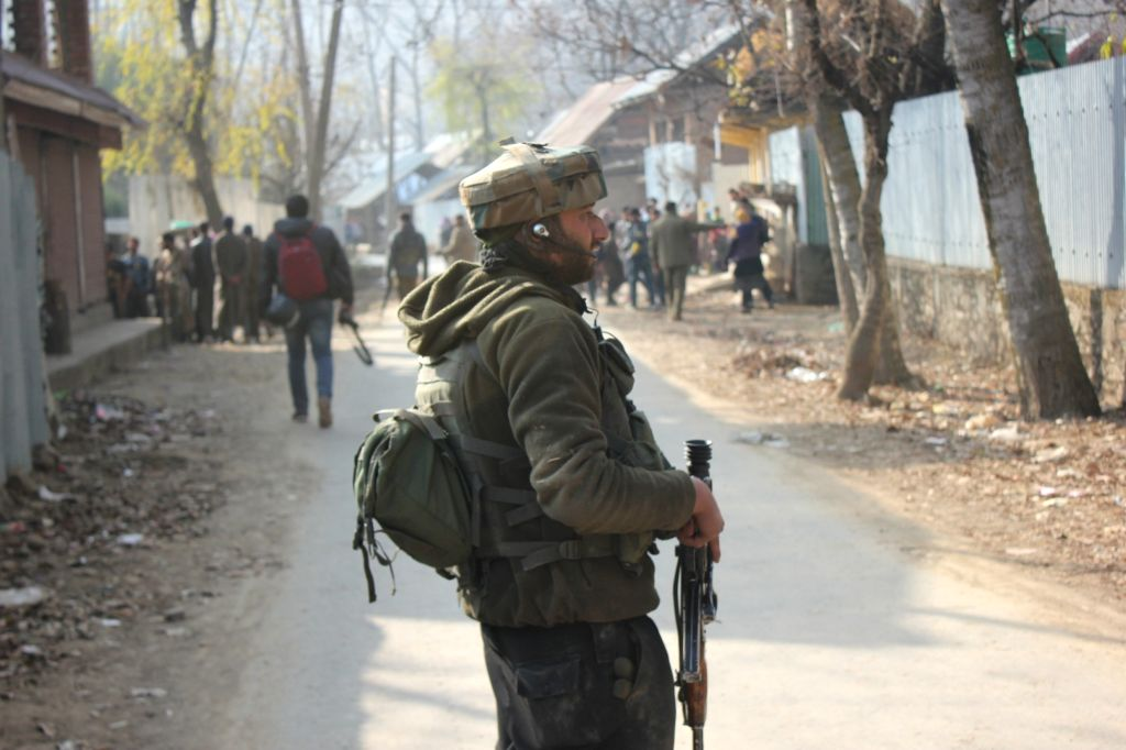 A soldier stands guard in Budgam of Jammu and Kashmir where three terrorists were killed in a gunfight between the security forces and militants on Nov 30, 2017.