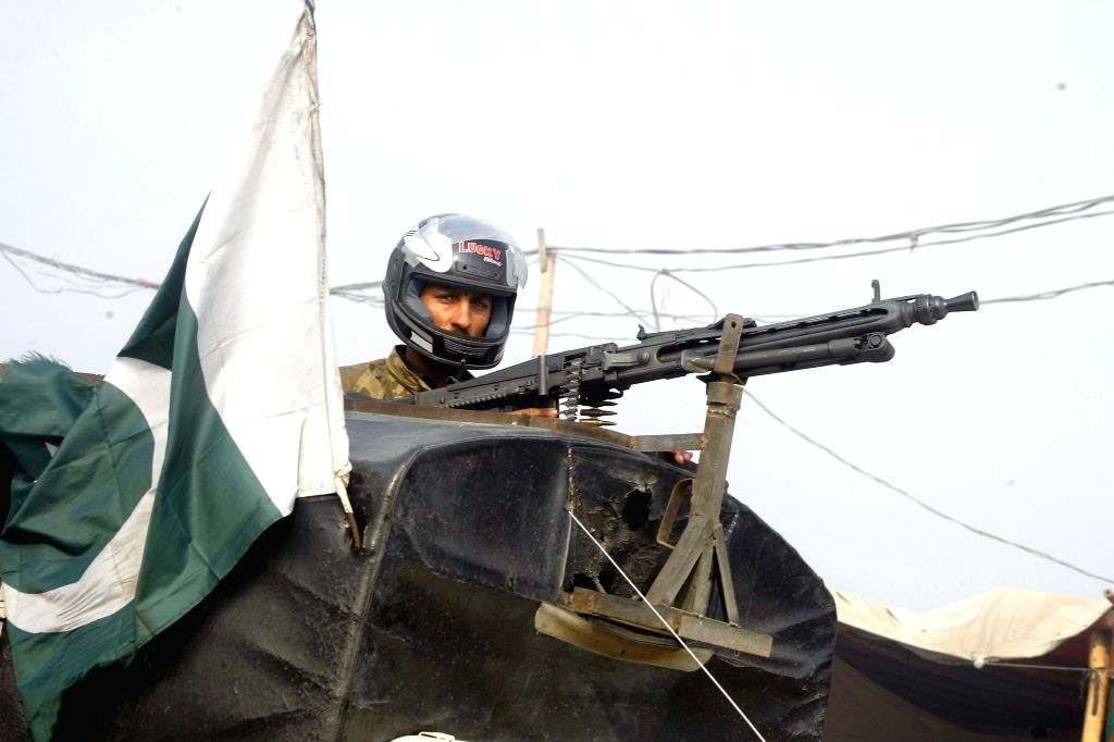 A soldier takes position at Bacha Khan University following an attack in northwest Pakistan's Charsadda, Jan. 20, 2016. At least eight people were killed and over ... - Bacha Khan University