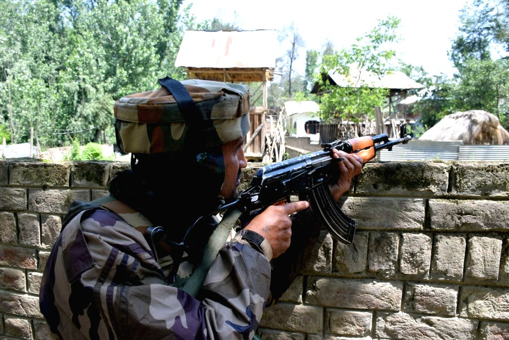 A soldier takes position during a gunfight with holed up militants in Jammu and Kashmir's Pulwama district, on June 14, 2019.