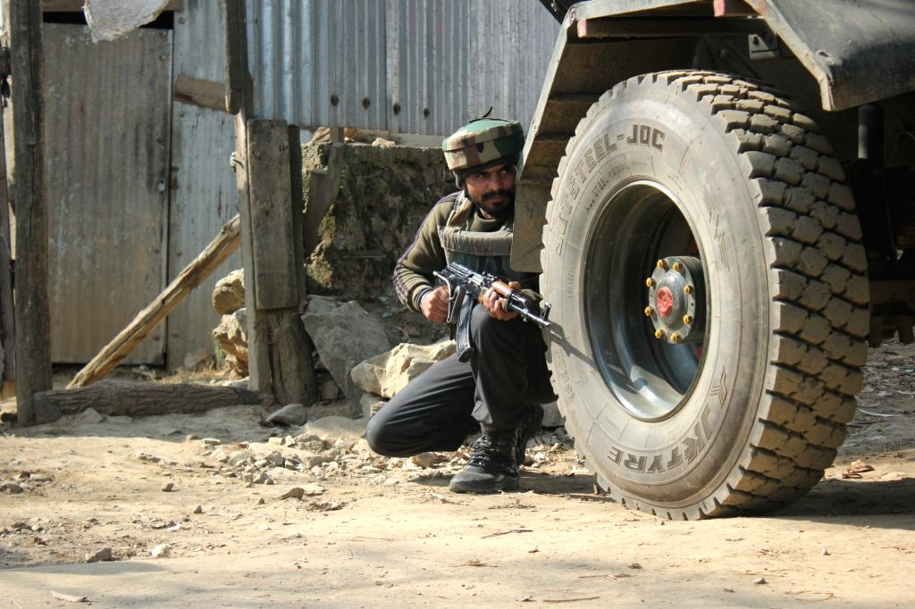 A soldier takes position during an encounter with terrorists in Budgam of Jammu and Kashmir on Nov 30, 2017. Three terrorists were killed.