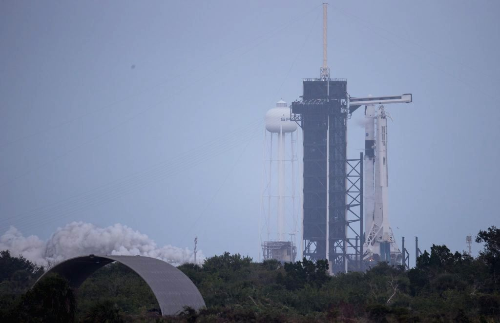 A SpaceX Falcon 9 rocket with the company???s Crew Dragon spacecraft onboard is seen on the launch pad at Launch Complex 39A during a brief static fire test ahead of NASA???s SpaceX Crew-1 mission at ...