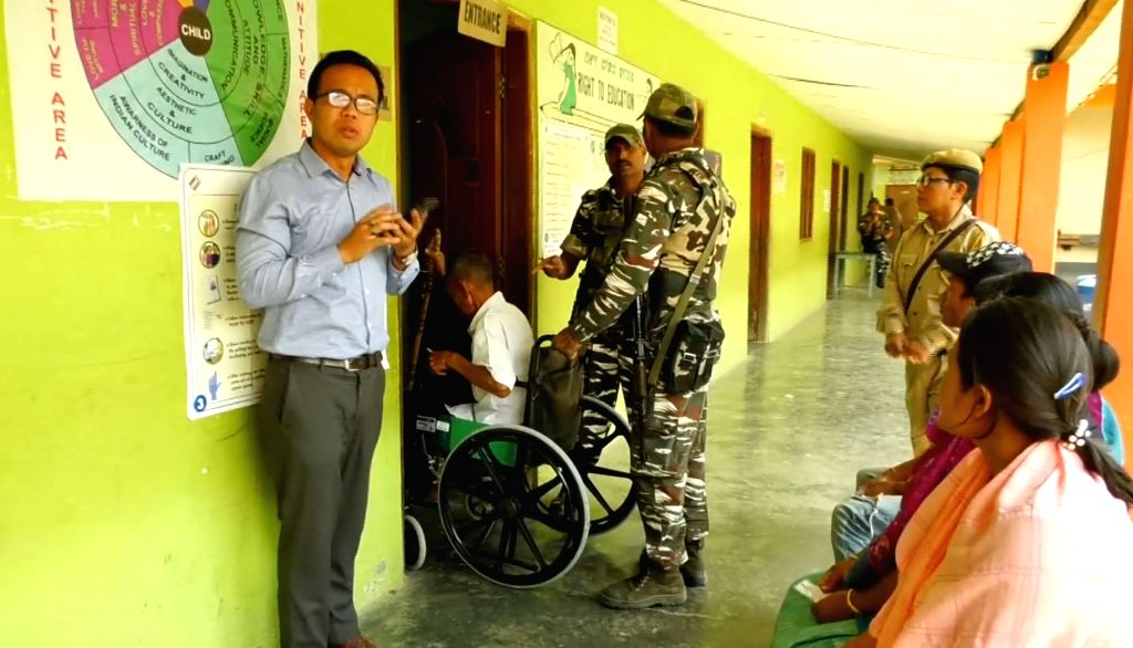 A specially able voter being escorted to a polling station to cast his vote during re-polling in 12 polling stations of the Inner Manipur Lok Sabha constituency for the 2019 Lok Sabha ...