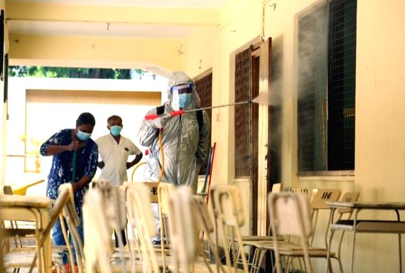 A staff member disinfects a classroom at a school in Colombo, Sri Lanka, Jan. 24, 2021.