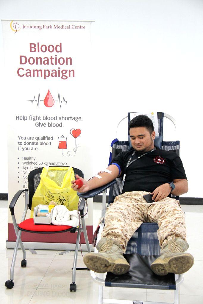 A staff member of Hengyi Industries Sdn Bhd donates blood in Bandar Seri Begawan, capital of Brunei, Aug. 13, 2020. Hengyi Industries Sdn Bhd, a ...