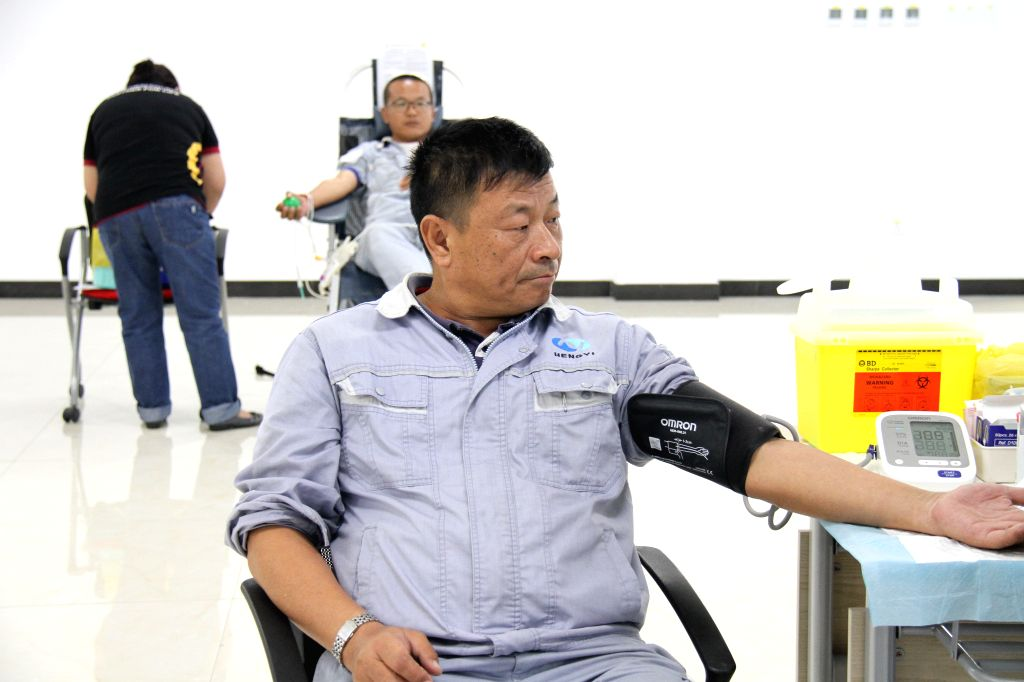 A staff member of Hengyi Industries Sdn Bhd has physical examination before participating in a blood donation in Bandar Seri Begawan, capital of Brunei, ...