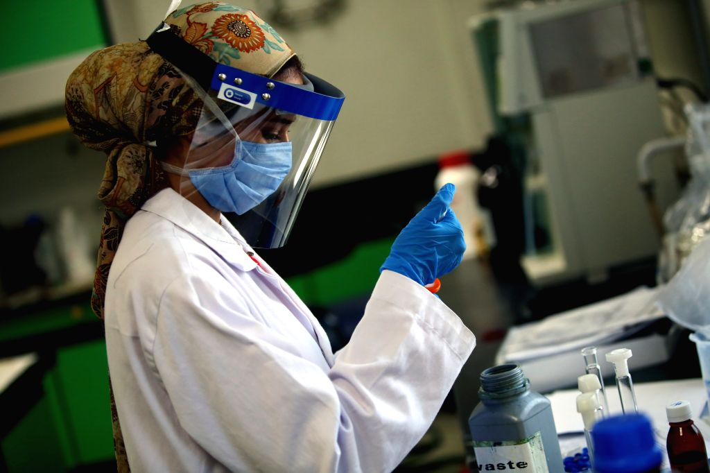 A staff member works in a lab of Eva Pharma drugmaker in Giza Province, Egypt, on July 2, 2020. TO GO WITH Feature: Egyptian pharmaceutical firm produces antiviral ...